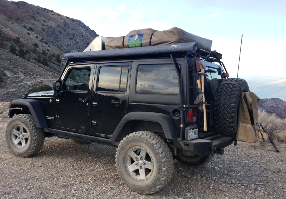Jeep customer out on the trail using the Fourtreks Awning, LED, Hilift and Shovel mounts on his rack!